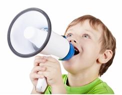 Boy shouting through a loudspeaker