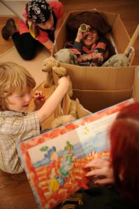 children playing with cardboard box